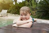 Young boy lying on decking - CUF13402