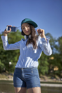 Portrait of dancing young woman with smartphone and headphones - BEF00096