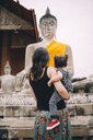 Thailand, Ayutthaya, back view of mother and little daughter visiting Wat Yai Chaya Mongkhon - GEMF02025