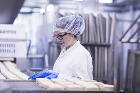 Woman working in food production factory - CUF14109
