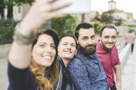 Group of friends taking selfie by roadside - CUF14251