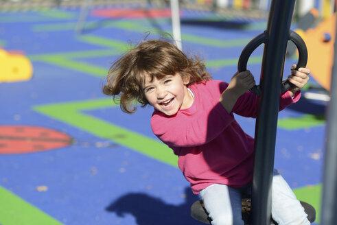 Portrait of happy little girl on  playground - JSMF00204