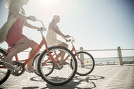 Young women cycling on seafront, Cape Town, South Africa - CUF14301