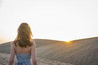 Rear view of woman strolling on dune, Maspalomas, Gran Canaria, Canary Islands, Spain - CUF14361