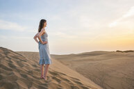 Woman standing looking out from dune, Maspalomas, Gran Canaria, Canary Islands, Spain - CUF14364