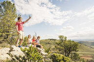 Young man and friends taking smartphone selfie on rocks, Bridger, Montana, USA - CUF14526