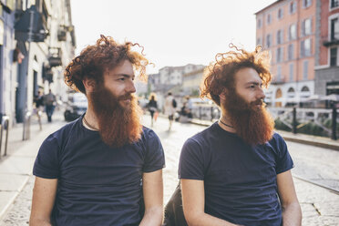 Young male hipster twins with red hair and beards on city street - CUF14654