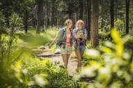 Teenage girl and young female hiker looking at map in forest, Red Lodge, Montana, USA - CUF14900