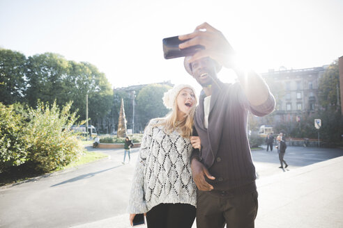 Couple taking selfie with smartphone in park - CUF14993