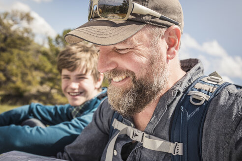 Close up of father and teenage son on hiking trip, Cody, Wyoming, USA - CUF15053