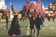 Russia, Moscow, young woman visiting Red Square at night - WPEF00347