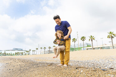 Spain, Barcelona, father holding his son on the beach - WPEF00365