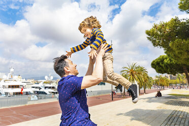 Spain, Barcelona, father and son playing together and having fun - WPEF00386