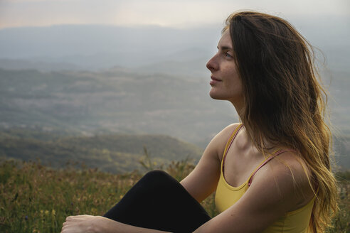 Spain, Barcelona, portrait of young woman relaxing on Montcau Mountain - AFVF00543
