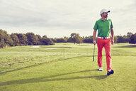 Golfer walking on course, Korschenbroich, Dusseldorf, Germany - CUF15260