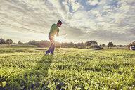 Golfer playing golf on course, Korschenbroich, Dusseldorf, Germany - CUF15278