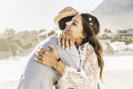 Romantic couple hugging each other on beach, Cape Town, South Africa - CUF15371