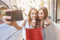 Girlfriends taking selfie while shopping in town - CUF16559