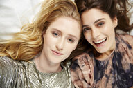 Overhead view of two beautiful young women posing for selfie - CUF16835