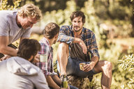 Four male hikers sitting in forest, Deer Park, Cape Town, South Africa - CUF17105