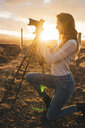 Iceland, female fotographer at sunset - KKAF01102