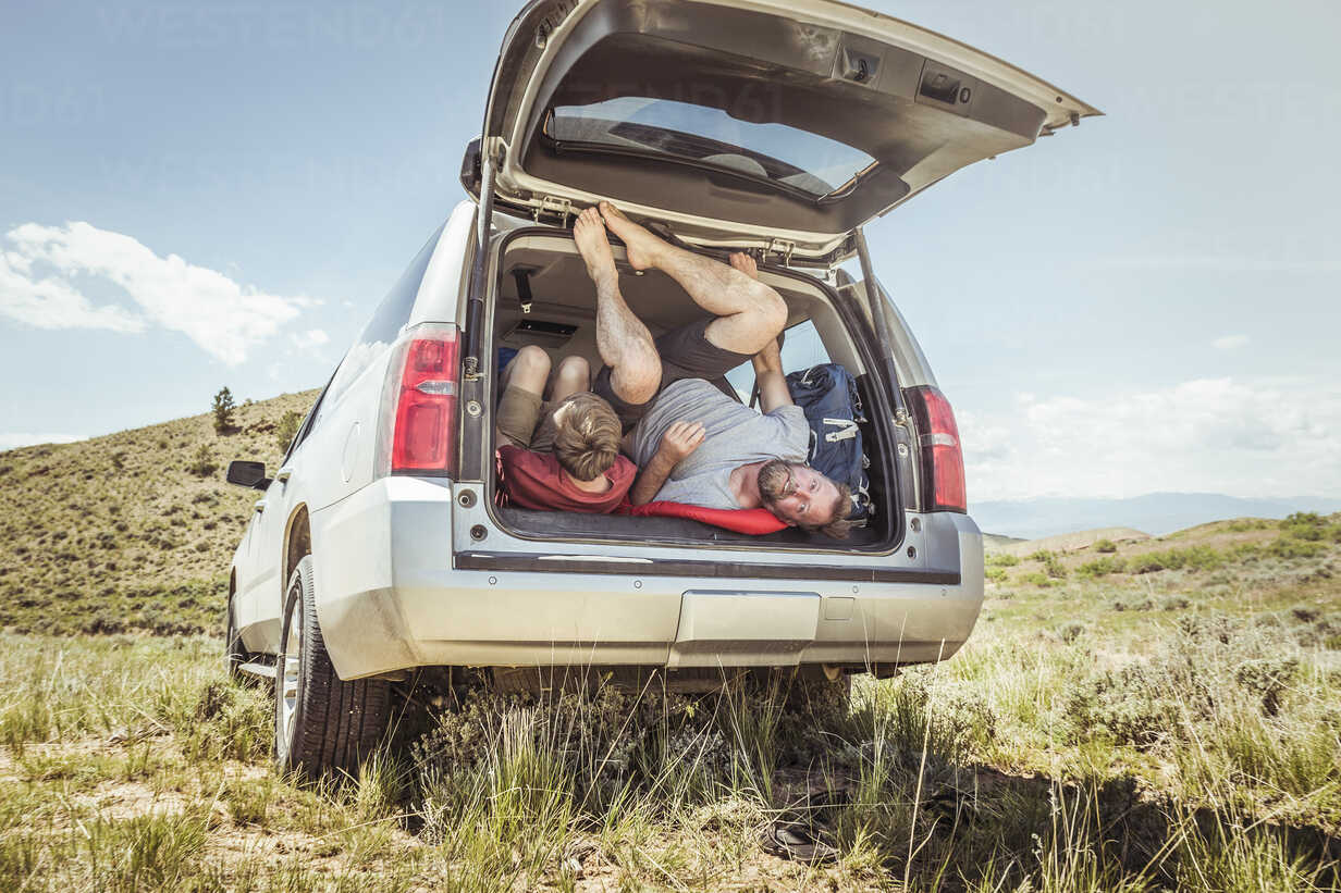 Mature man and teenage son getting out of off road vehicle, Bridger, Montana, USA - CUF17417 - SuHP/Westend61