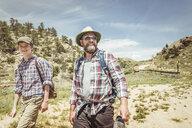 Man and teenage son hiking in landscape, Bridger, Montana, USA - CUF17435