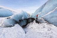 Woman exploring glacier, Solheimajokull, Iceland - CUF17444