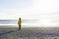 Woman enjoying beach, Reynisfjara, Iceland - CUF17510