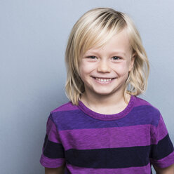 Portrait of blonde haired boy looking at camera smiling - ISF06720