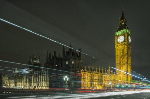 Traffic light trails passing Westminster Palace and Big Ben at night, London, UK - CUF18024
