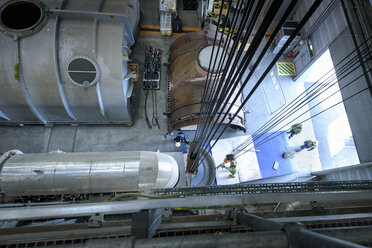 Engineers crane steam turbine parts during outage in gas-fired power station - CUF18149