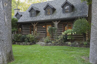 Exterior of Canadian cottage style home with cedar shingles and garden - ISF06916