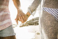 Couple holding hands on beach - CUF18316