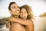 Happy couple hugging on beach - CUF18352