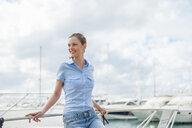 Beautiful woman leaning against marina yacht, Majorca, Spain - CUF18770