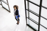 High angle view of businesswoman arriving in  office entrance - CUF19474