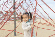 Portrait of little girl in climbing frame - AFVF00563