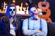 Portrait of spooky couple at Halloween party - ABIF00467