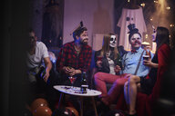 Group of friends celebrating Halloween - ABIF00473