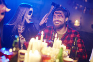 Couple at a Halloween party - ABIF00491
