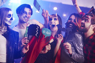 Friends in creepy costumes having fun at Halloween party - ABIF00494