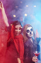 Women in creepy costumes dancing at Halloween party - ABIF00509