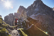 Rear view of female hiker hiking in Dolomites, Sexten, South Tyrol, Italy - CUF19951