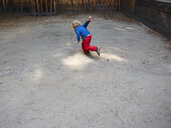 Back view of running little boy on playground - MUF01536