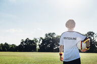 Boy wearing football shirt with Germany written on back - MJF02309