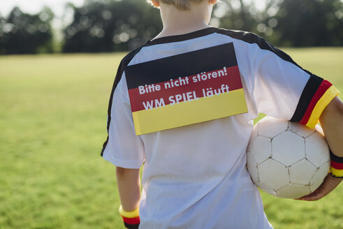 Boy showing do not disturb sign due to soccer world championship - MJF02318