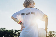Boy wearing football shirt with Germany written on back - MJF02333