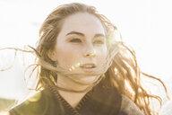 Woman enjoying breeze on sunny day - CUF20493