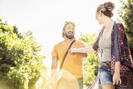 Happy young couple holding hands in park, Franschhoek, South Africa - CUF20634